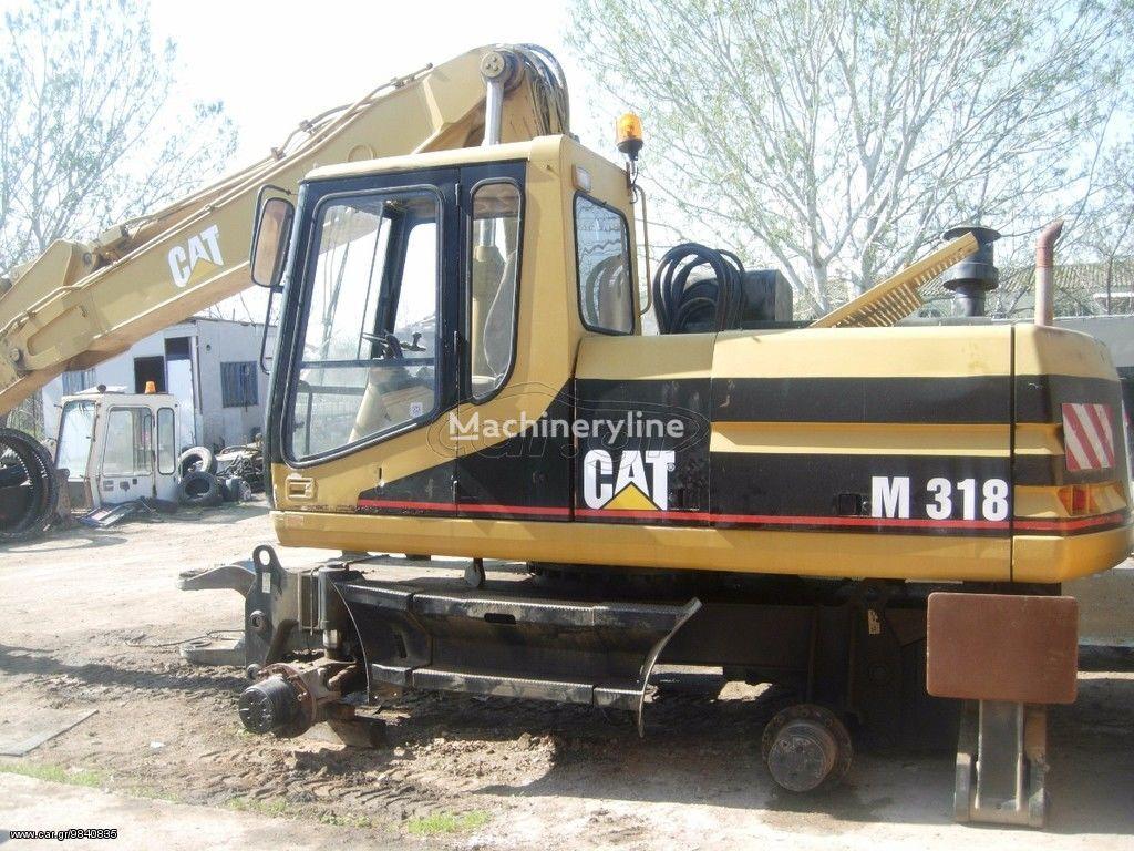 excavator pe şenile CATERPILLAR M318 în bucăți