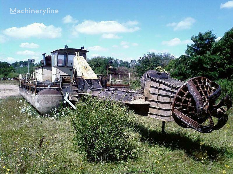 CATERPILLAR Caterpillar / warmann excavator plutitor accidentate