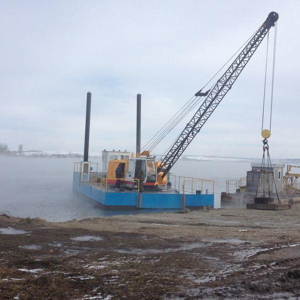 TOPLYaKOPODEMNIK GREYFER excavator plutitor
